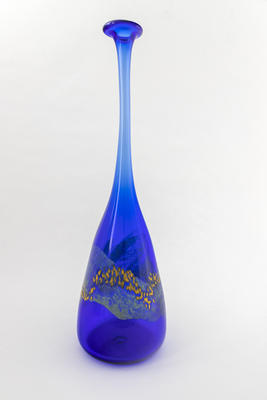 Tall blue bottle with surface design
