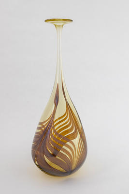 Tall amber bottle with surface feathering